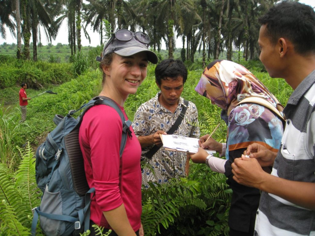 Sarah Luke with collaborators in the field