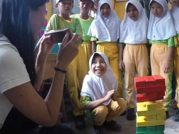 Children playing ecology jenga at school