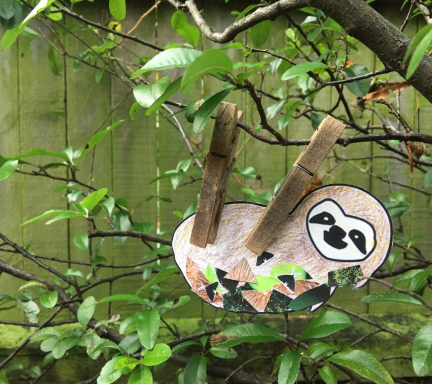 Sloth craft finished, hanging from a branch in a tree