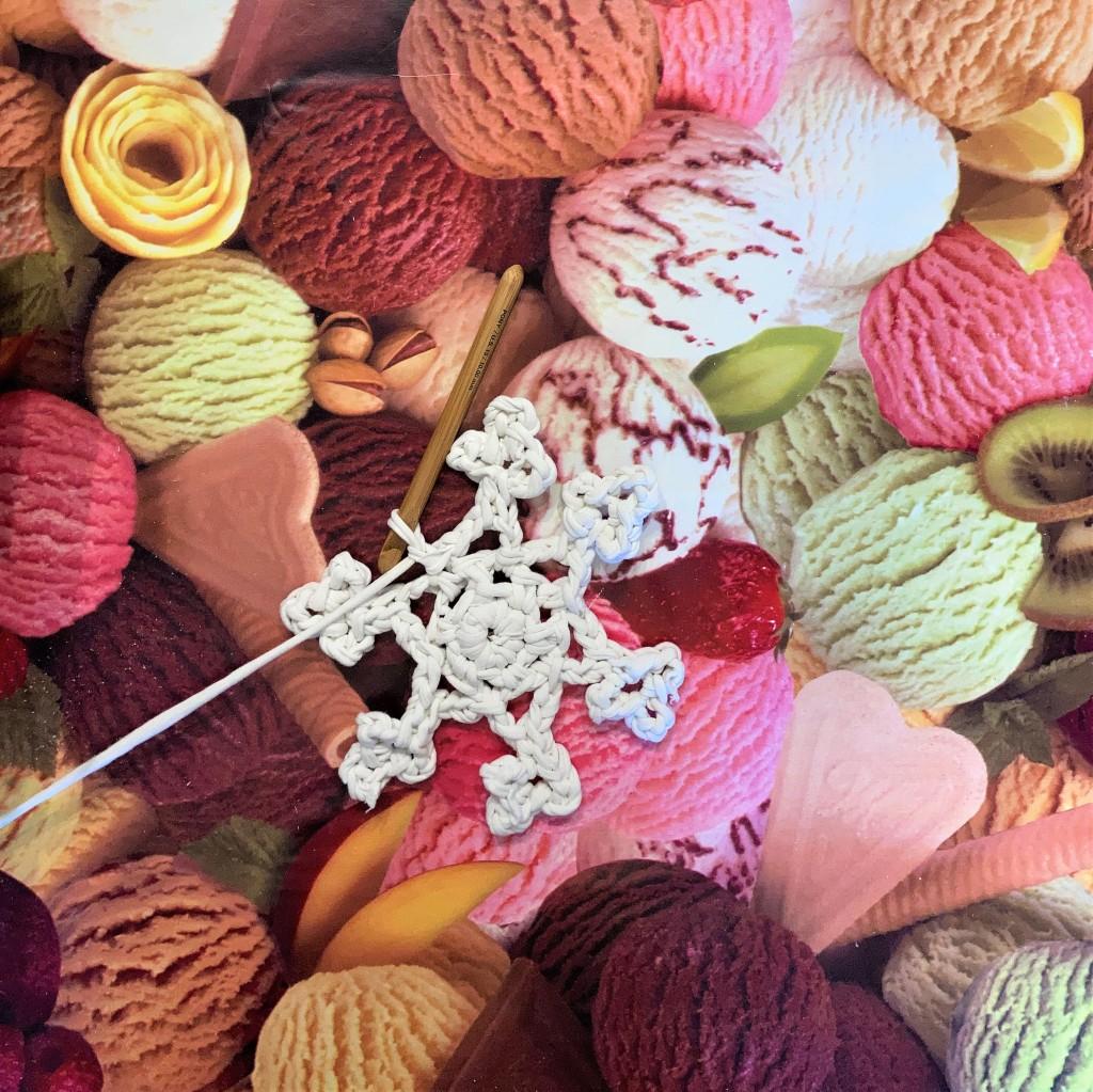 Crochet snowflake made using t-shirt yarn