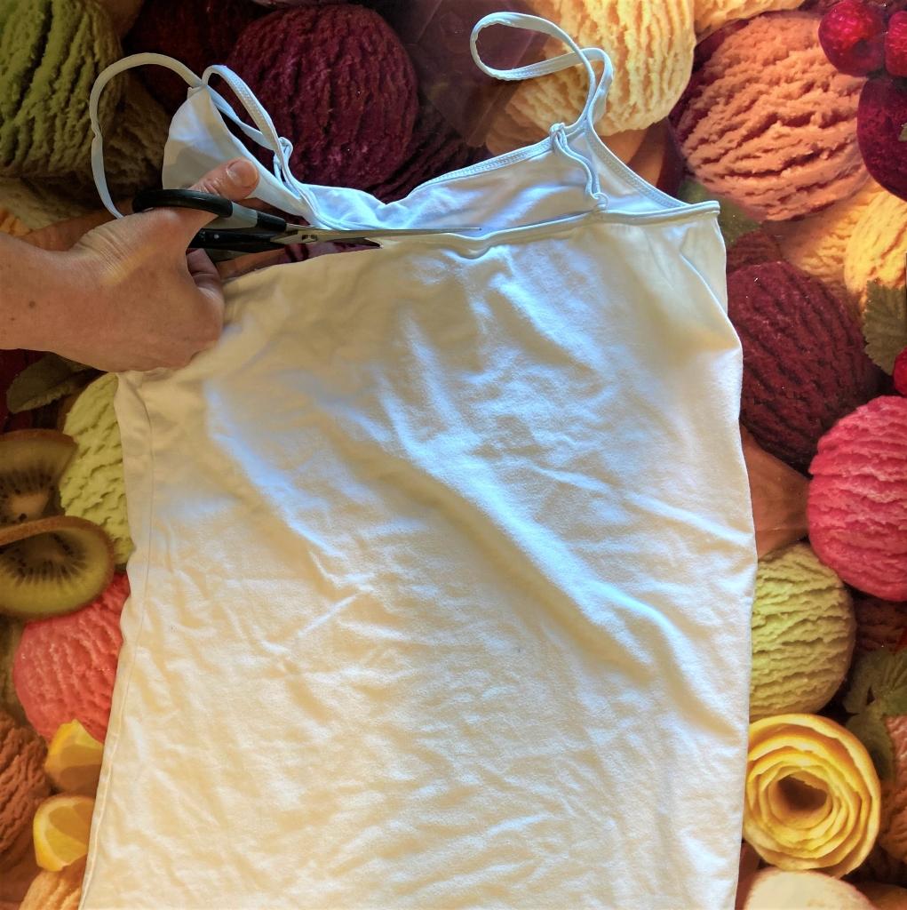 Cutting across a vest top beneath the arm holes