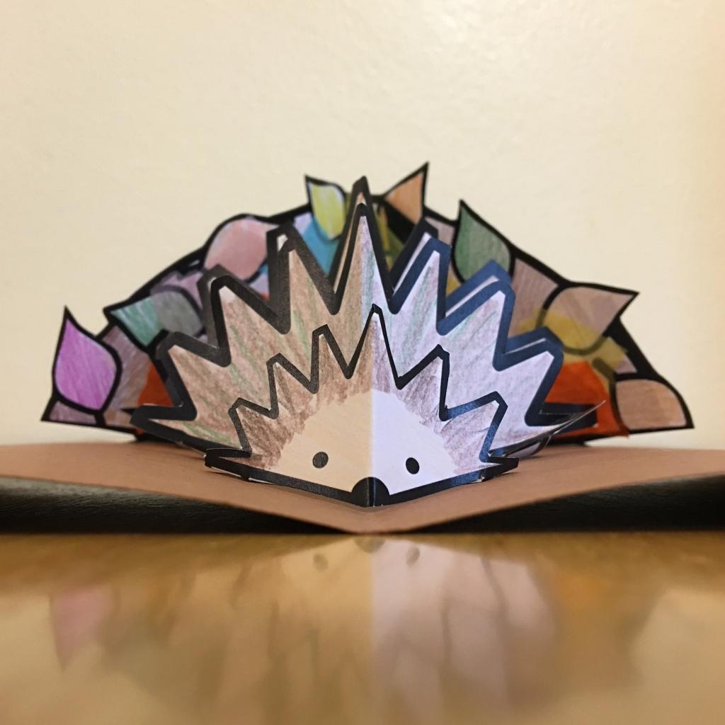 Pop-up hedgehog in a leaf pile craft