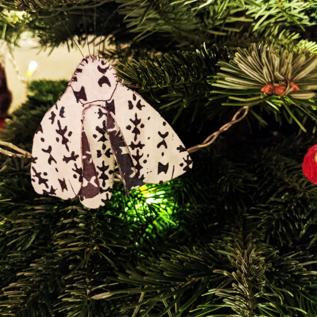 Completed moth craft as tree decoration