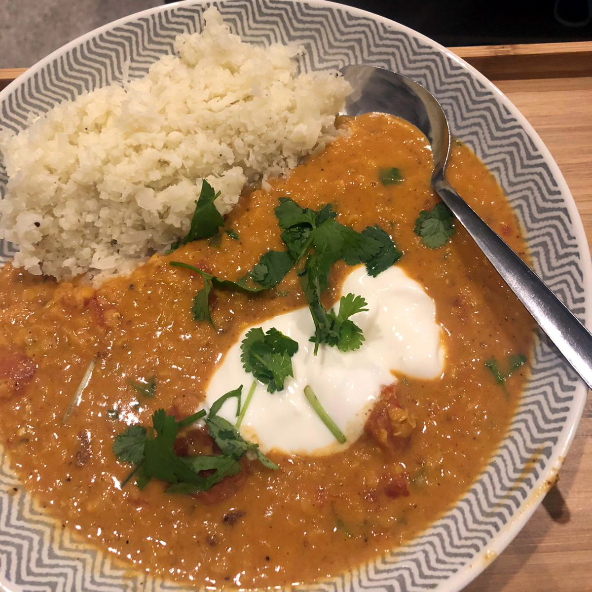 Red lentil dhaal with cauliflower rice in a bowl