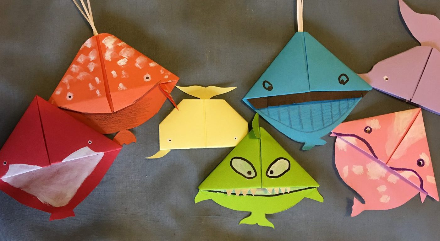 Seven whale bookmarks in different colours