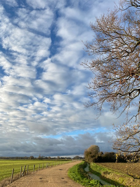 Cloud formation above a country path