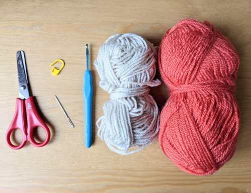 Materials including yarn, hook, needle and scissors