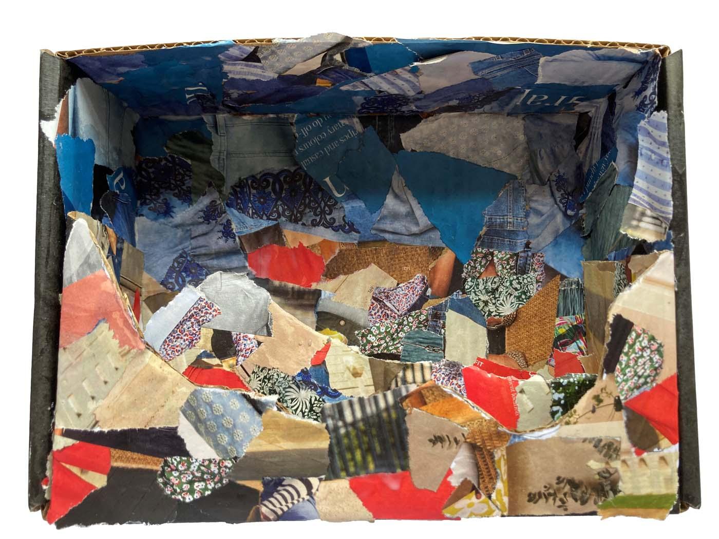Backdrop for a rockpool made of card and collage